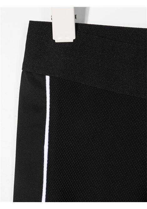 dkny leggins con profili a contrasto e con stampa scritta logo DKNY | Leggins | D34A1109B