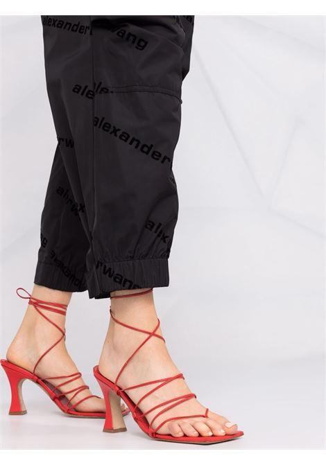 Black all-over logo print trousers - women  ALEXANDER WANG | UWC4214020001