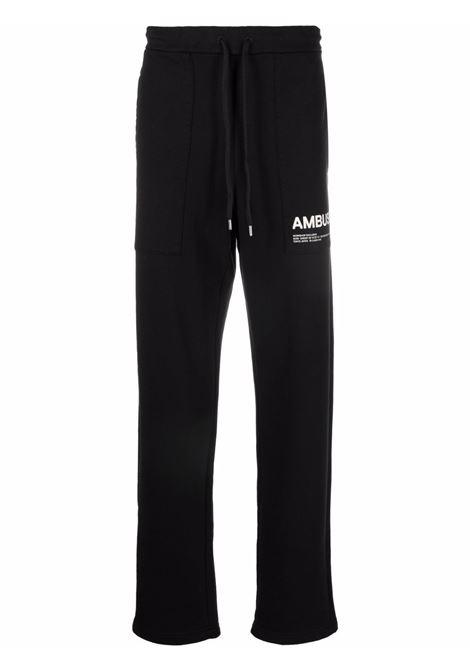 Black logo-embroidered trousers - men  AMBUSH | BMCH003F21FLE0011001