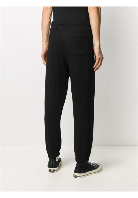 Logo-embroidered track trousers in black - men  CARHARTT | I0282840300FXX