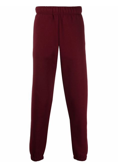 Logo-embroidered track trousers in red - men  CARHARTT | I028284030HNXX