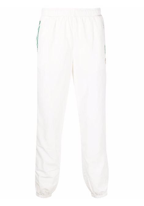 Logo-patch track trousers in white - men  CASABLANCA | MF21TR028CASASPORTTCHNCL