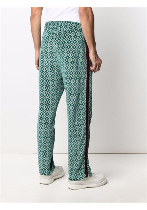 Textured side-stripe straight trousers in emerald green and red - men DRÔLE DE MONSIEUR   FW21BP007GN