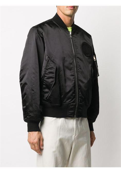 Logo patch bomber jacket in black - men  ÉTUDES | E17M04501