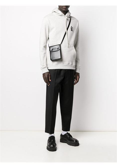 Pressed-crease elasticated-waist trousers in black - men ÉTUDES | E18M62001