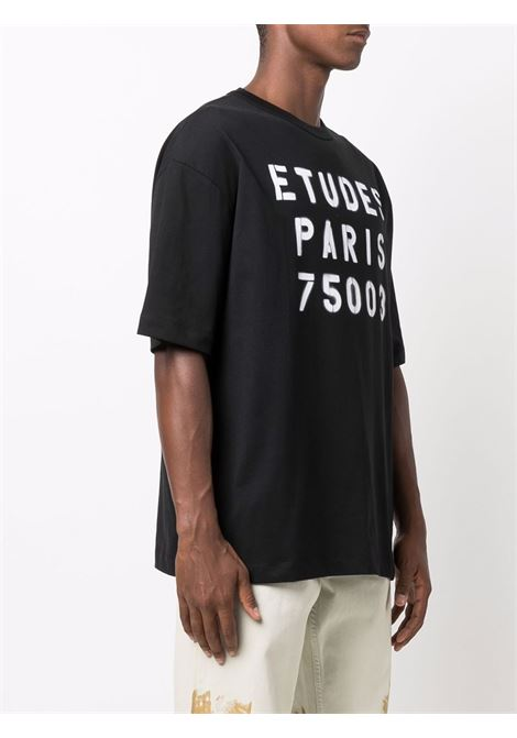 Oversized logo-print T-shirt in black and white - men  ÉTUDES | E19E40201
