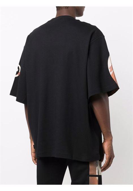 T-shirt con stampa camouflage in nero - uomo GCDS | CC94M02152602