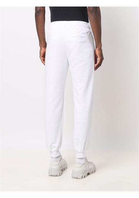 White logo-tape detail track trousers - men  GCDS | CC94M03150301