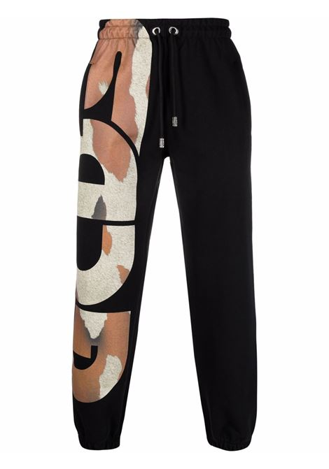 Pantaloni con stampa camouflage in nero - uomo GCDS | CC94M03152002