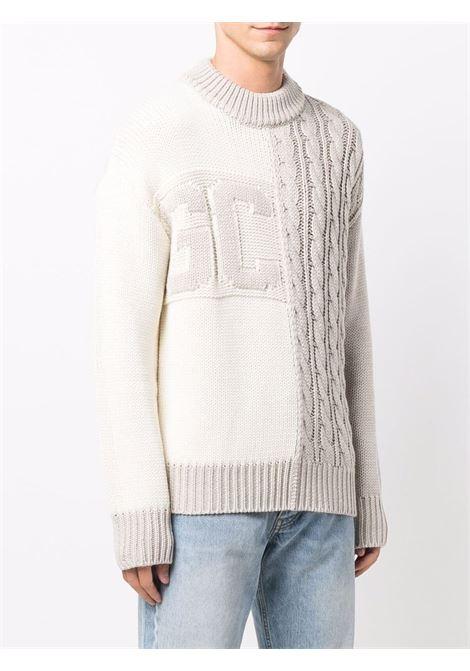Maglione con design a trecce con logo in beige - uomo GCDS | FW22M02000166