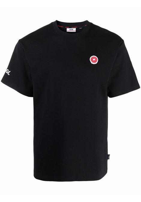 T-shirt con logo a ciambella in nero - uomo GCDS | FW22M02005402