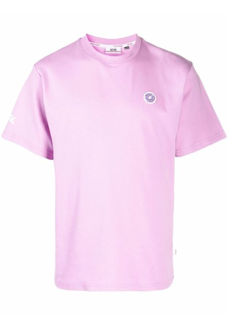 T-shirt con logo a ciambella in lilla - uomo GCDS | FW22M02005462