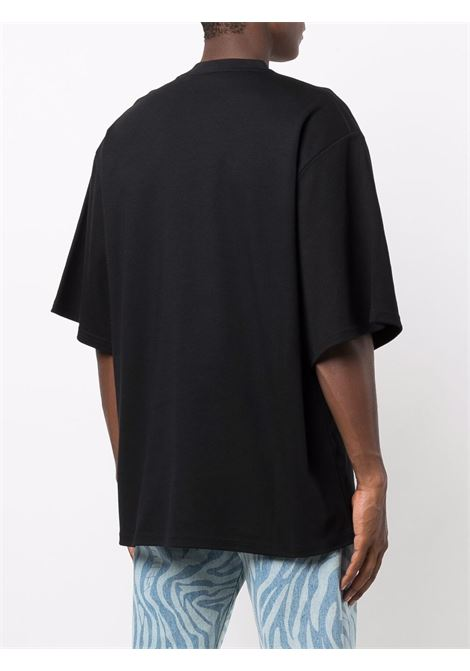 T-shirt con stampa grafica in nero - uomo GCDS | FW22M02006702
