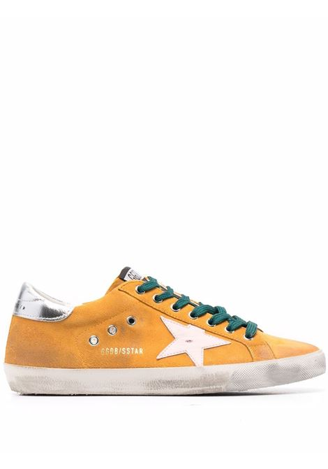 Sneakers superstar con effetto vissuto in giallo - uomo GOLDEN GOOSE | Sneakers | GMF00101F00167730244