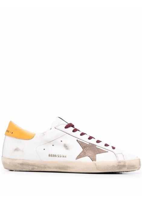 Sneakers Superstar con effetto vissuto in bianco e giallo - Uomo GOLDEN GOOSE | GMF00101F00202510766