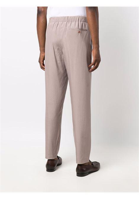 Pantaloni con vita elasticizzata in beige -unisex LEMAIRE | X213PA174LF634303