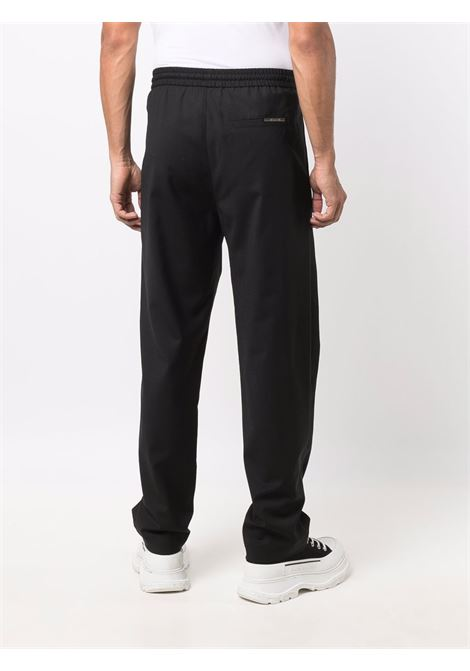 Jetted-pocket track trousers in black - men LES HOMMES | LLP110320U9000