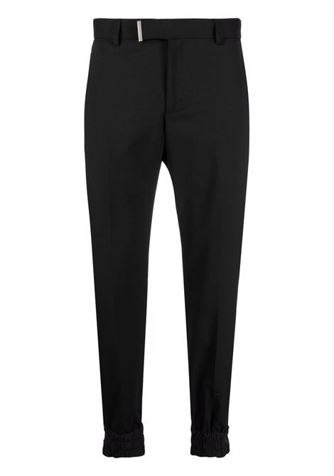 Tapered tailored trousers in black - men  LES HOMMES | LLP132321B9000