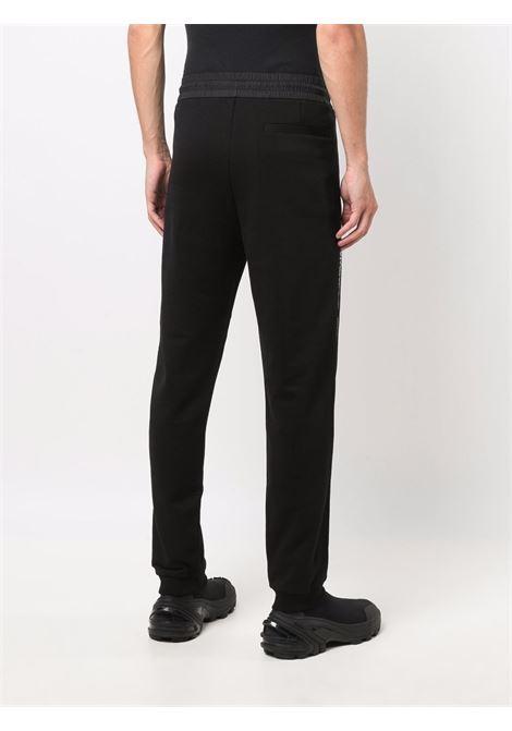 Side stripe track trousers in black - men  MONCLER | 8H00007809KR999