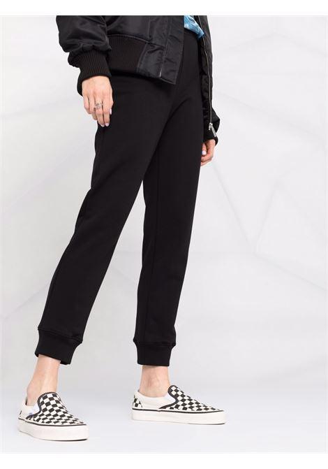 Pantaloni sportivi con stampa in nero - donna MOSCHINO | J030554271555