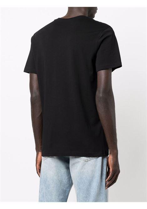 T-shirt con logo multicolore  in nero - uomo MOSCHINO | J071452401555