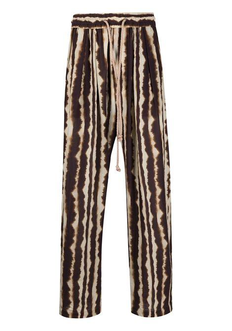 Brown/beige tie-dye stripe trousers - men NANUSHKA | Trousers | NM21PFPA00877
