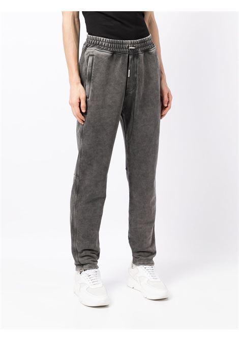Drawstring-waist trousers in faded grey - men REPRESENT   M0809320