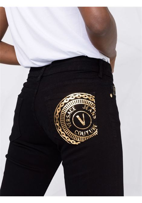 Jeans slim V-Emblem in nero - donna VERSACE JEANS COUTURE | 71HABCK1CDW00909