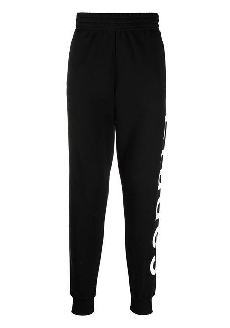Logo-print track trousers in black - men  ÉTUDES | E18E60101