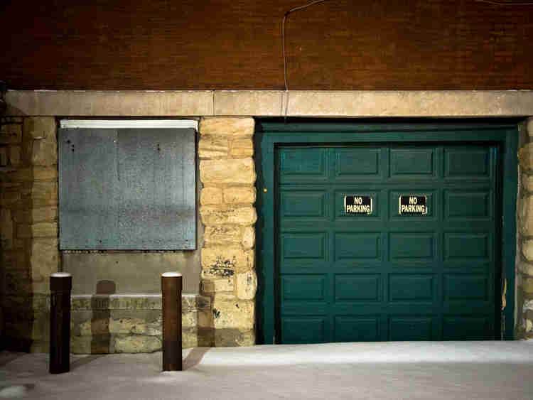 Green garage with no parking signs in the River Market in Kansas City, Missouri