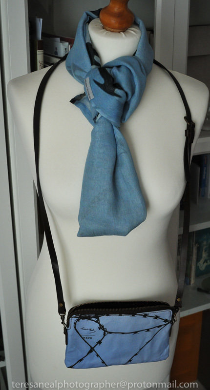 Razzor long modal scarf worn with Femme clutch bag