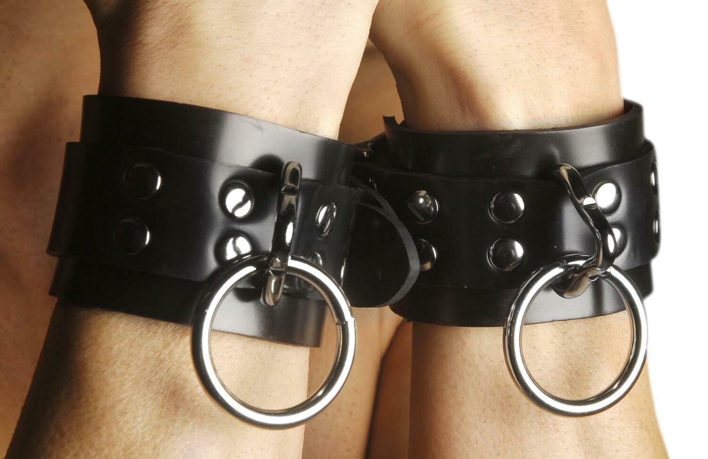 Wrist restraint with hasp lock
