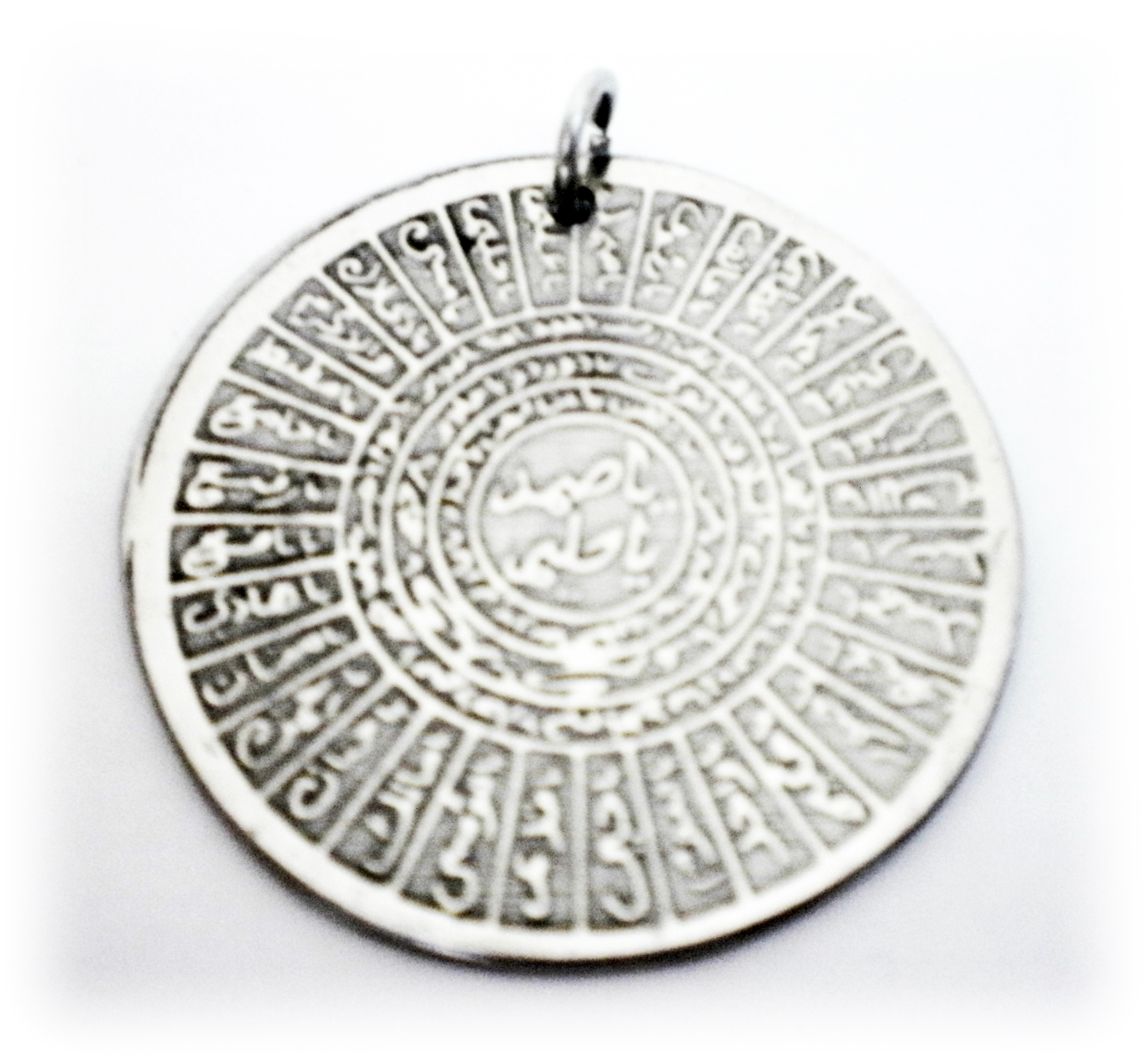Sacred metal pendant inscribed with islamic spells for love and sacred metal pendant inscribed with islamic spells aloadofball Images