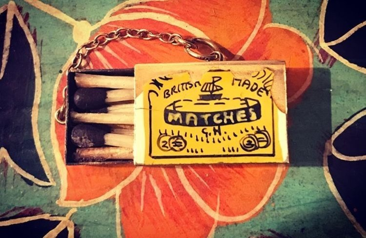 1965 Gold opening matchbox charm 00000