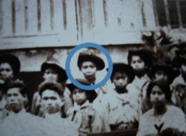 A picture of a boy in a school visit made by Luang Por Plien, which if you look carefully and study, will reveal itself to be the face of a well known and now deceased Royal High Monk; The Sangkaracha Somdej Prayan Sangworn, who himself passed away in 2557 at the age of 100 years Old