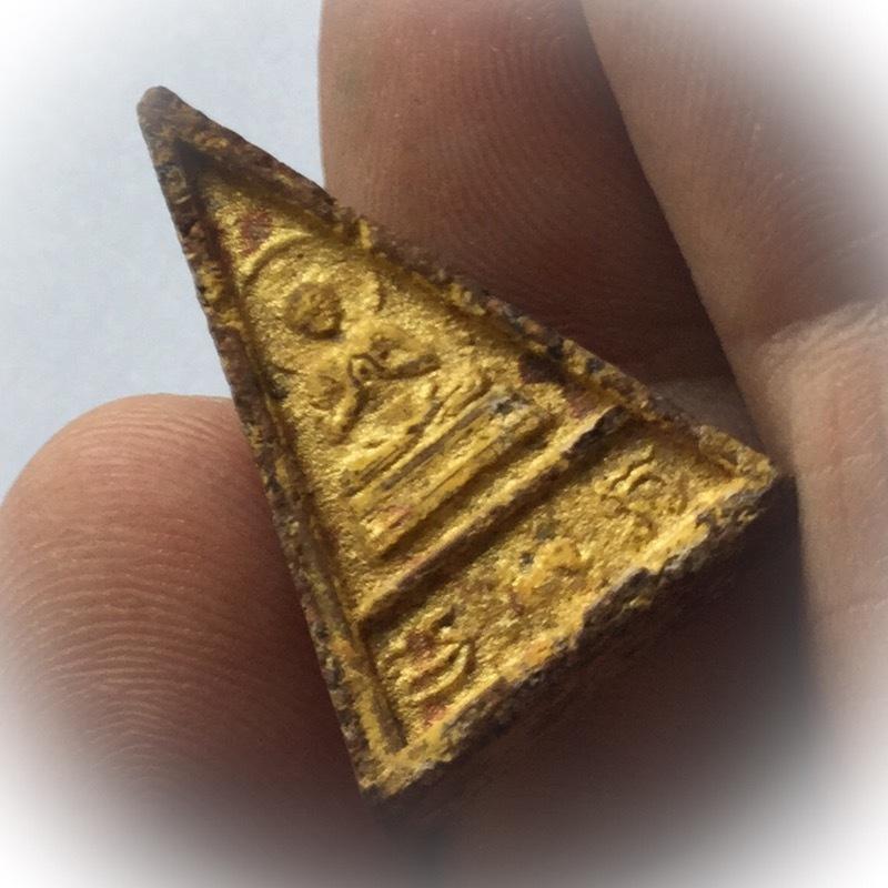 side view of amulet Pra Pim Wua Singh Luang Por Pina