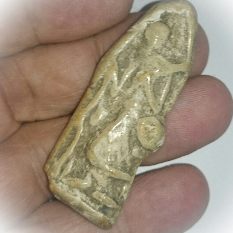 Pra Sivali amulet Luang Por Guay in hand for size comparison