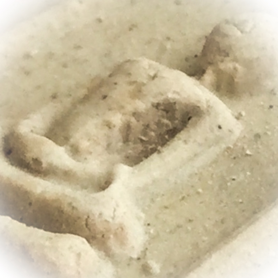 A Macro Close Up Image of the Muan Sarn Powders on the surface of the Pra Somdej Amulet