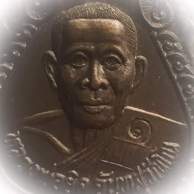 Luang Por Yid Cameo Close up Macro Image of front face of amulet