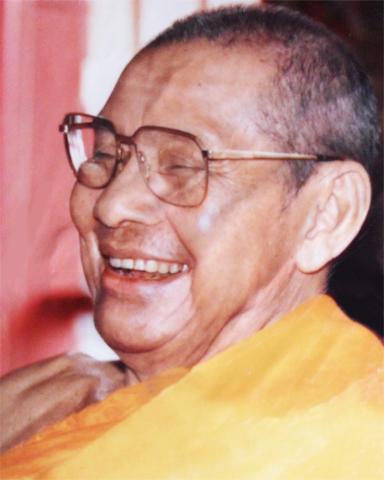 Photo of Luang Por Ruesi Ling Dam Laughing