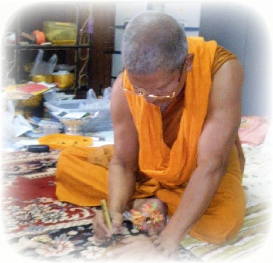 Luang Por Prohm Inscribing Amulets at Wat Ban Suan