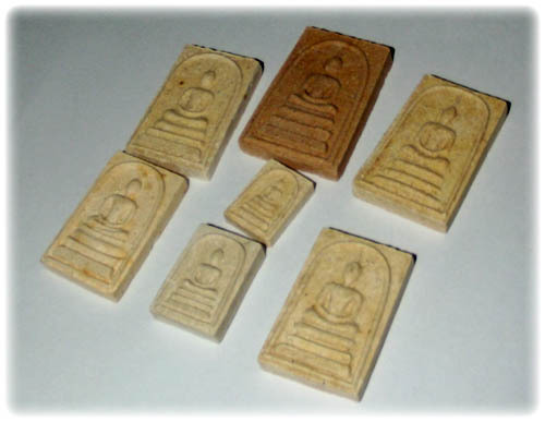 Side view of Pra Somdej Gammagarn seven amulet collectors set of Wat Jao Arm