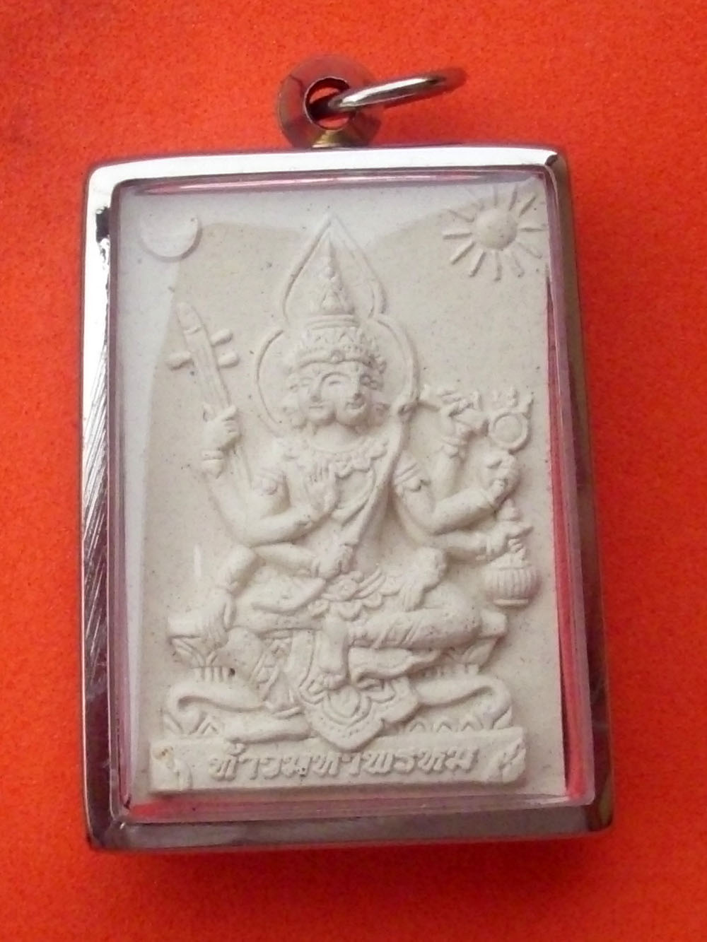 Brahma amulet in sacred powder with precious stone inserts
