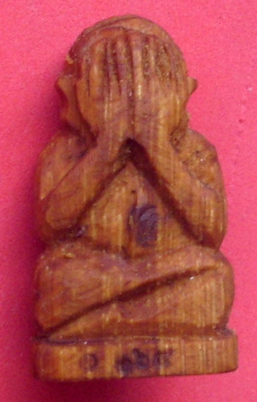 hand carved wooden Pra Pid Ta Thai amulet with ruby and sacre powder soaked in metta oil