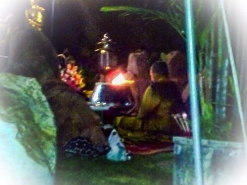 Kroo Ba Krissana Intawano blessing amulets inside the sacred cave