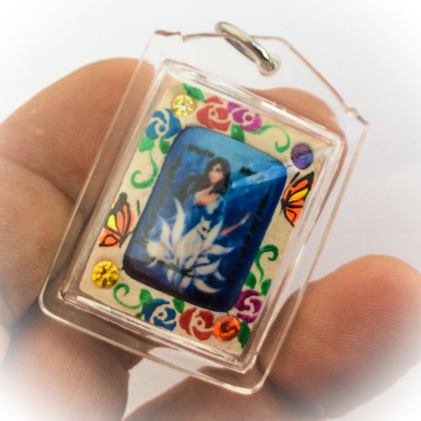 Nang Jing Jork Gao Hang Nine Tailed Fox Prai Deva on rear face of Taep Jamlaeng Butterfly King Amulet