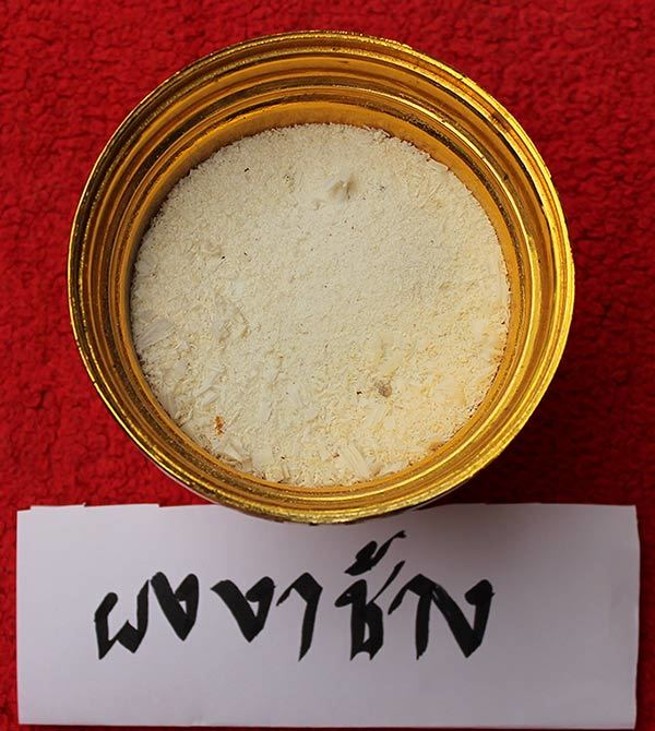 Pong Nga Chang (Ivory Tusk Powder) - this is not only Sacred and Magickally Powerful, but also an important ingredient that is used in recognising and differentiating authentic Khun Phaen Pong Prai Kumarn of this edition, from fakes - fakes can not afford this expensive ingredient, and can be seen to be missing from the Muan Sarn powders when examined under the eye-loupe when fake)
