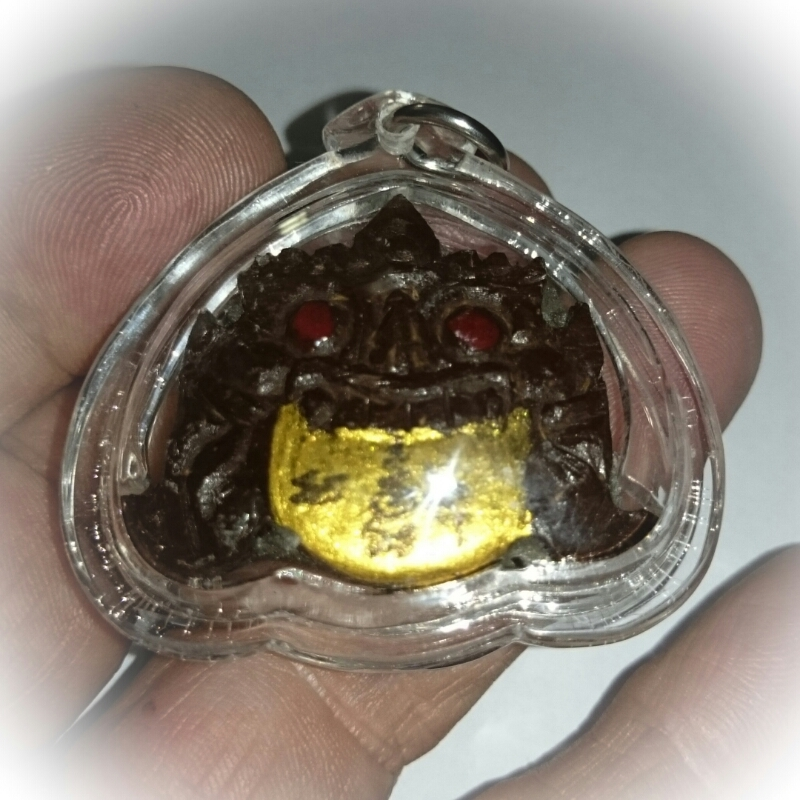 Rahu amulet in hand for size comparison