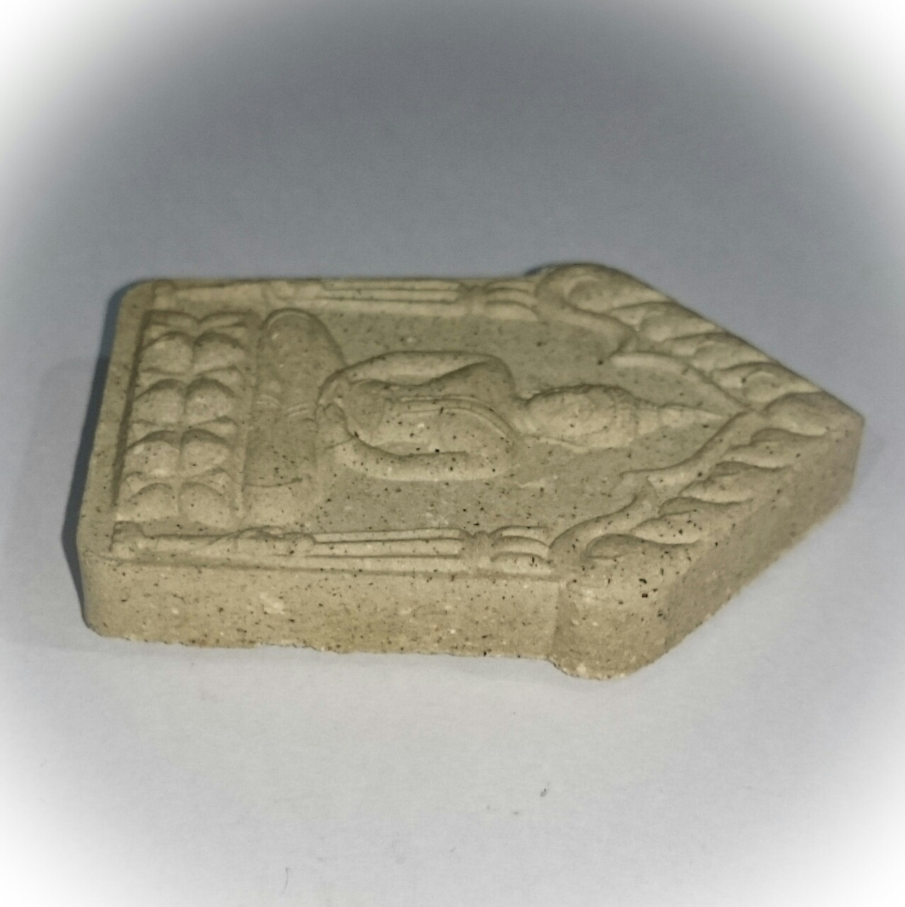 side view of amulet