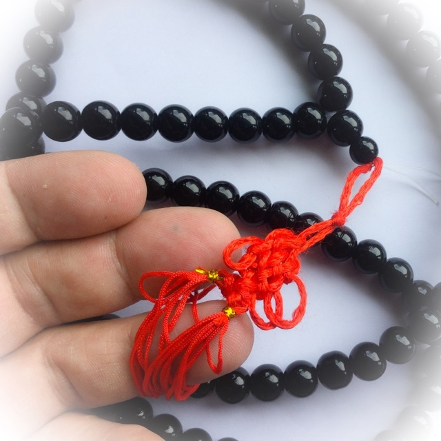black hematite beads with red cord